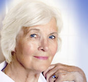 Senior lady. Portrait, bright background royalty free stock images