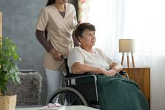 Lady with alzheimer`s disease. Senior lady with alzheimer`s disease, sitting in a wheelchair, confused about where she is stock photos