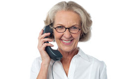Senior lady attending phone call Stock Photos