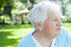 Senior lady in back yard Royalty Free Stock Photography