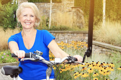 Senior lady on a bike Stock Images