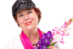 Senior Lady With Black Hat and Gladious Flowers Stock Photography