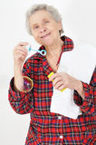 Senior lady blowing soap bubbles Royalty Free Stock Photography