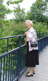 Senior lady on bridge Stock Images