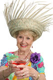 Senior Lady - Cheers. A beautiful senior lady on vacation making a toast with her tropical cocktail. Isolated stock image