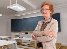 Senior lady in a classroom royalty free stock photography