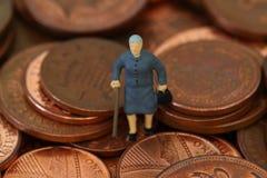 Senior lady coins B. Miniature model of a senior lady on British coins Stock Photo