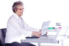 Senior lady on computer Royalty Free Stock Photos