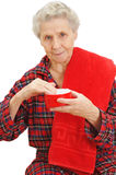 Senior lady with cream Stock Photography