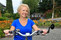 Senior lady cyclist Royalty Free Stock Photography