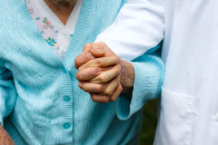 Senior lady with doctor Stock Images
