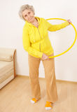 Senior lady doing gymnastic Stock Image