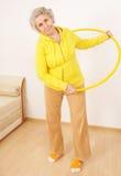 Senior lady doing gymnastic. With hula-hoop Stock Image