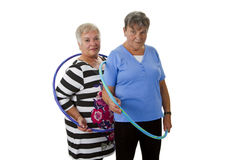 Senior lady doing gymnastic with hula hoop Royalty Free Stock Photos