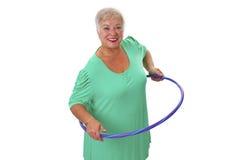 Senior lady doing gymnastic Royalty Free Stock Images