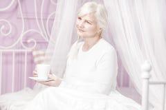 Senior lady drinking coffee. Stock Photo