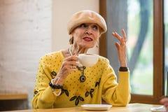 Senior lady drinking coffee. Stock Image