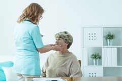 Senior lady examined by doctor Royalty Free Stock Photos
