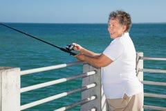 Senior Lady Fishing Royalty Free Stock Image