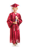 Senior Lady Graduates with Honors. Senior lady graduating college with honors, holding her diploma.  Full body isolated on white Royalty Free Stock Photo