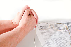 Senior Lady hands with income tax forms Royalty Free Stock Photo