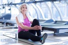 Senior lady having pause at gym Royalty Free Stock Photography