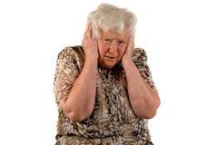 Senior lady with headache Stock Photo
