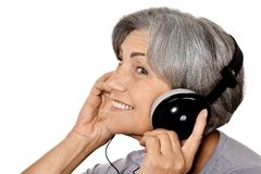 Senior lady in headphones Royalty Free Stock Image