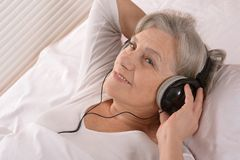 Senior lady in headphones Stock Photo