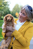 Senior lady and her dog. Royalty Free Stock Photography