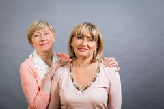 Senior lady with her middle-aged daughter Royalty Free Stock Images