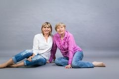Senior lady with her middle-aged daughter Royalty Free Stock Photos