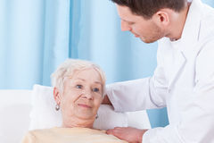 Senior lady and her physiotherapist Royalty Free Stock Image