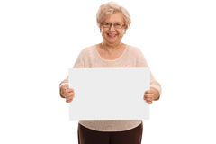 Senior lady holding a blank signboard Royalty Free Stock Photography