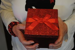 Top view of red gift held by a woman Royalty Free Stock Photos
