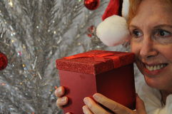 Senior lady holding red Christmas gift box Stock Photo
