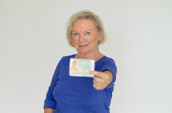Senior lady holding out her business card Stock Photography