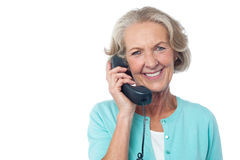 Senior Lady Holding Phone Receiver Royalty Free Stock Images