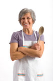 Senior lady holding a wooden spoon Royalty Free Stock Photography