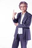 Senior lady with index finger upwards Royalty Free Stock Photography