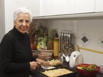Senior lady at kitchen Stock Photography