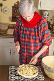 Senior Lady in Kitchen Royalty Free Stock Photography