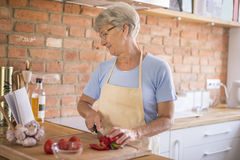 Senior lady in the kitchen Royalty Free Stock Image