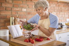 Senior lady in the kitchen Stock Images