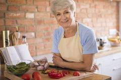 Senior lady in the kitchen Royalty Free Stock Photo