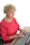 Senior Lady Learns Computer Royalty Free Stock Image