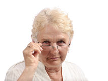 Senior lady looking above glasses Royalty Free Stock Photos