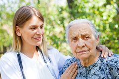 Senior woman with physician in the park stock photography