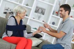 Senior lady needs to take pills. Senior lady needs to take her pills Royalty Free Stock Image