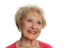 Senior Lady Optimistic. A beautiful senior woman looking hopeful and optimistic.  Isolated on white Stock Photo